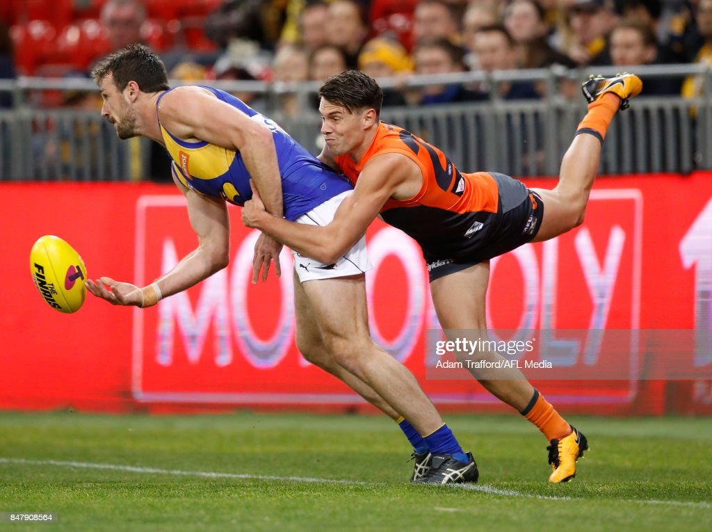 Eric Mackenzie of the Eagles is tackled by Josh Kelly of the Giants during the 2017 AFL First Semi Final match between the GWS Giants and the West Coast Eagles at Spotless Stadium on September 16, 2017 in Sydney, Australia.