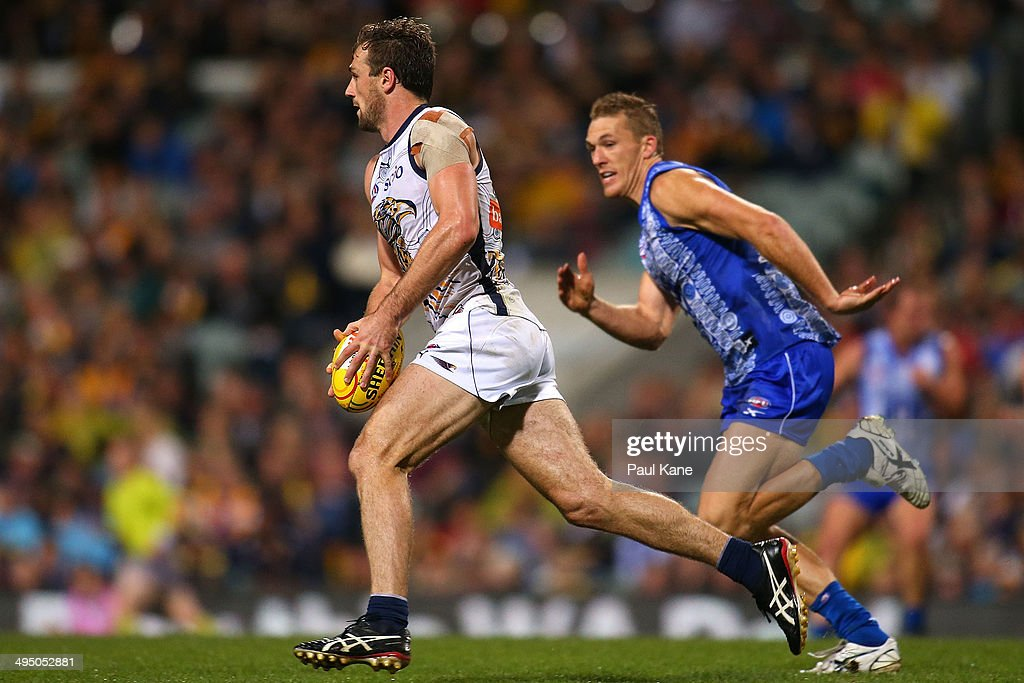Eric Mackenzie of the Eagles looks to pass the ball during the round 11 AFL match between the West Coast Eagles and the North Melbourne Kangaroos at Patersons Stadium on June 1, 2014 in Perth, Australia.