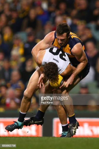 Eric Mackenzie of the Eagles tackles Charlie Curnow of the Blues during the round 21 AFL match between the West Coast Eagles and the Carlton Blues at...