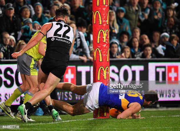 Eric Mackenzie of the Eagles takes the ball over the line as Charlie Dixon of the Power competes for the ball during the AFL First Elimination Final...