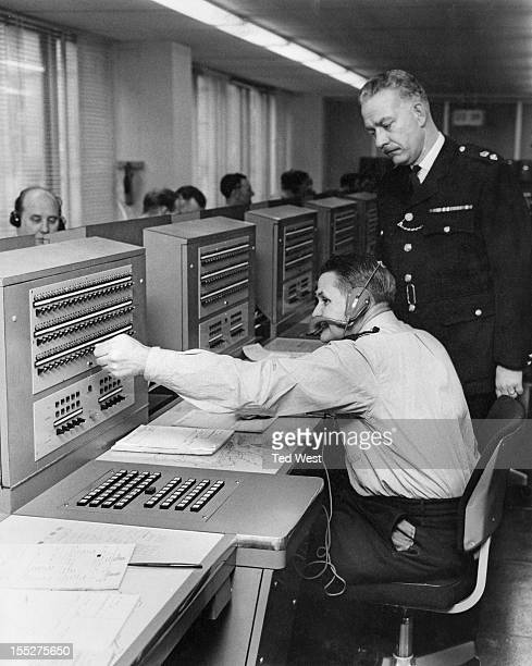 Eric Mathews Superintendent in Charge of Communications oversees the equipment in the information room at the new premises of New Scotland Yard the...