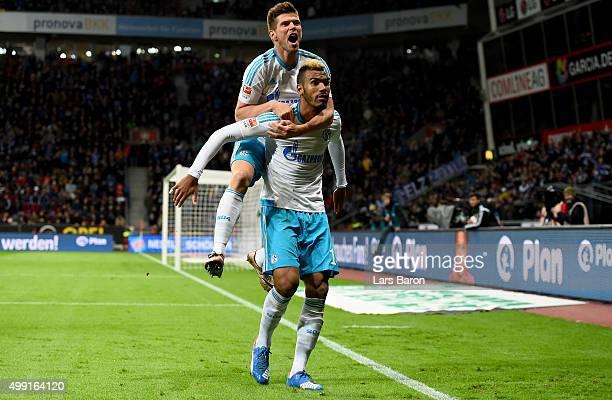 Eric Maxim Choupo Moting of Schalke celebrates scoring his teams first goal with team mate Klaas Jan Huntelaar of Schalke during the Bundesliga match...