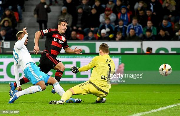 Eric Maxim Choupo Moting of Schalke scores his teams first goal during the Bundesliga match between Bayer Leverkusen and FC Schalke 04 at BayArena on...
