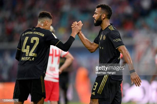 Eric Maxim Choupo-Moting and Jamal Musiala of Muenchen celebrate their teams fourth goal during the Bundesliga match between RB Leipzig and FC Bayern...