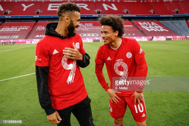 Eric Maxim Choupo-Moting and Leroy Sane of Bayern Muenchen celebrate winning the league title after the Bundesliga match between FC Bayern Muenchen...
