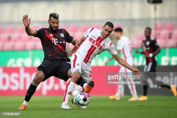 Eric Maxim ChoupoMoting is challenged by Ellyes Skhiri of 1FC Koeln during the Bundesliga match between 1 FC Koeln and FC Bayern Muenchen at...