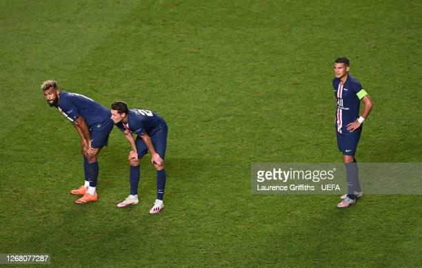 Eric Maxim Choupo-Moting, Julian Draxler, and Thiago Silva of Paris Saint-Germain look dejected following their team's defeat in the UEFA Champions...