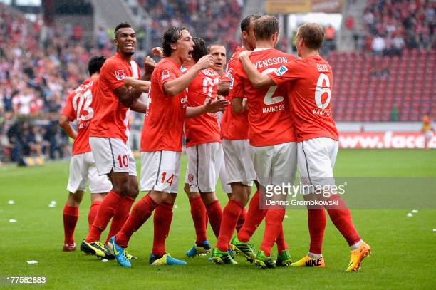 Eric Maxim ChoupoMoting of 1 FSV Mainz 05 celebrates with teammates after scoring his team's first goal during the Bundesliga match between 1 FSV...