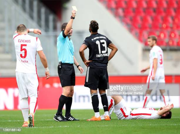 Eric Maxim ChoupoMoting of Bayern Munich is shown the yellow card by referee Frank Willenborg during the Bundesliga match between 1 FC Koeln and FC...