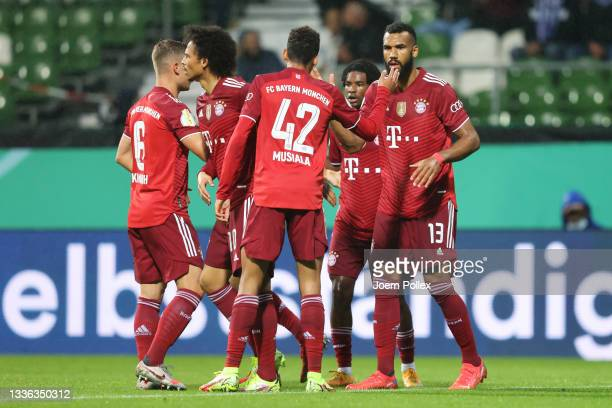 Eric Maxim Choupo-Moting of FC Bayern Muenchen celebrates with Jamal Musiala and teammates after scoring their team's first goal during the DFB Cup...