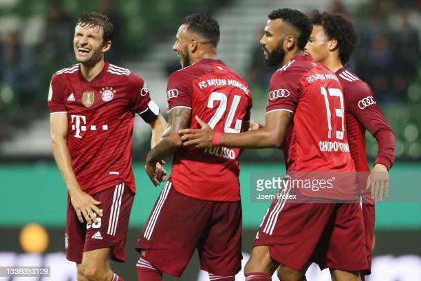 Eric Maxim Choupo-Moting of FC Bayern Muenchen celebrates with teammates Thomas Mueller, Corentin Tolisso and Leroy Sane after scoring their team's...