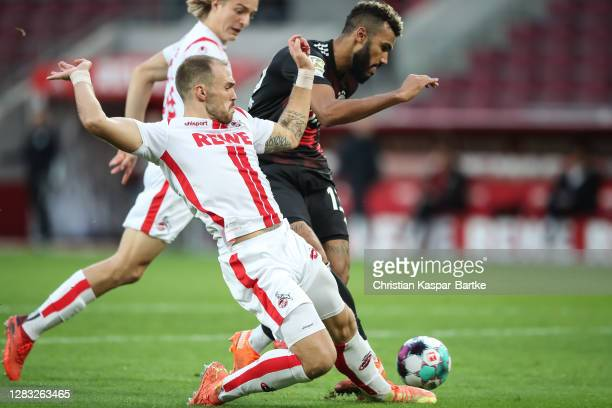 Eric Maxim ChoupoMoting of FC Bayern Muenchen is challenged by Rafael Czichos of 1FC Koeln during the Bundesliga match between 1 FC Koeln and FC...
