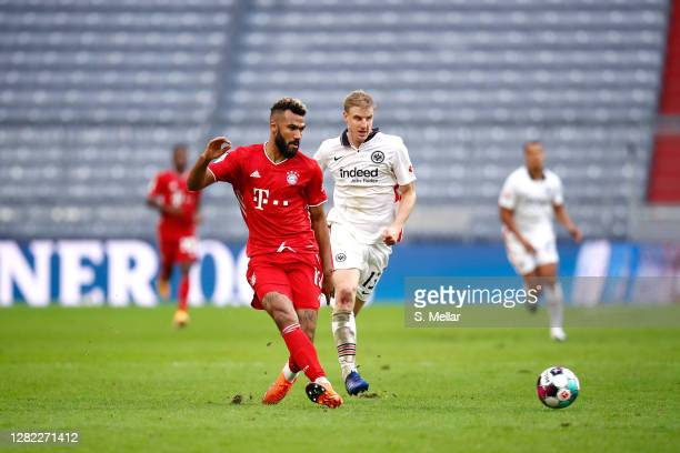 Eric Maxim ChoupoMoting of FC Bayern Muenchen plays the ball next to Martin Hinteregger of Eintracht Frankfurt during the Bundesliga match between FC...