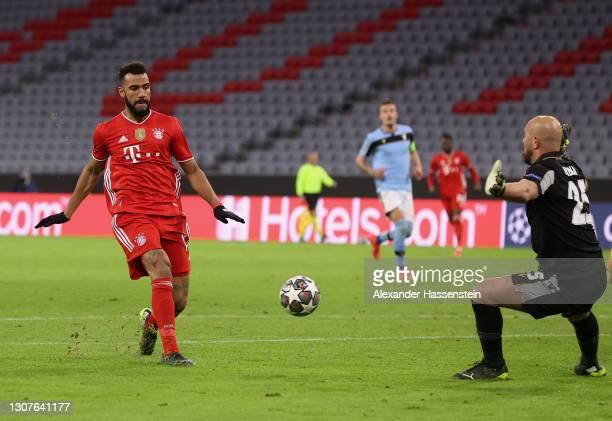 Eric Maxim Choupo-Moting of FC Bayern Muenchen scores their team's second goal during the UEFA Champions League Round of 16 match between Bayern...