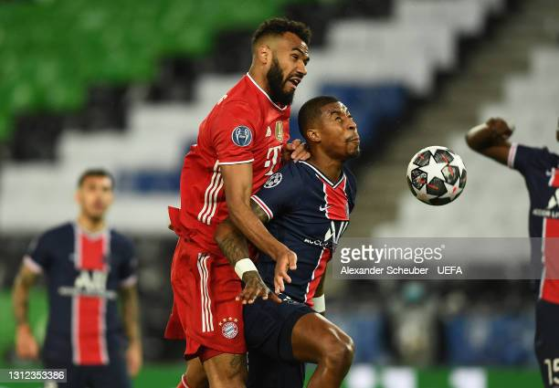 Eric Maxim Choupo-Moting of FC Bayern Muenchen scores their team's first goal under pressure from Presnel Kimpembe of Paris Saint-Germain during the...
