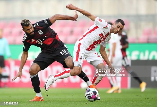 Eric Maxim ChoupoMoting of FC Bayern Munich battles for possession with Ellyes Skhiri of 1 FC Koln during the Bundesliga match between 1 FC Koeln and...