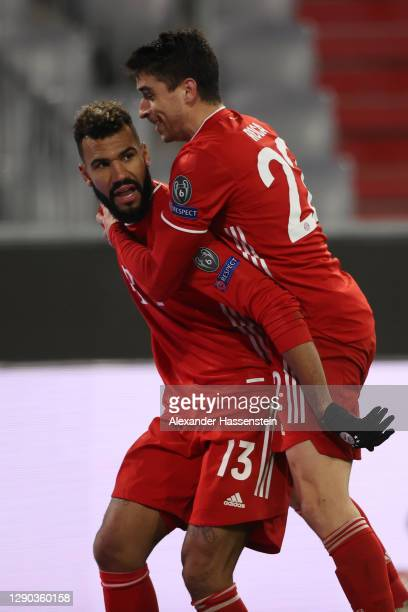 Eric Maxim Choupo-Moting of FC Bayern Munich celebrates with team mate Marc Roca after scoring their sides second goal during the UEFA Champions...