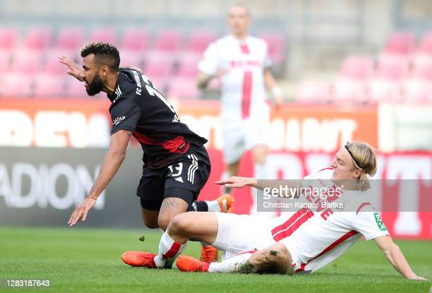 Eric Maxim ChoupoMoting of FC Bayern Munich is challenged by Sebastiaan Bornauw of 1 FC Koln during the Bundesliga match between 1 FC Koeln and FC...