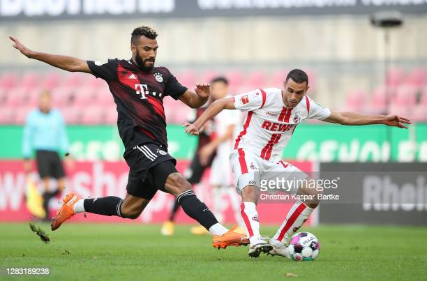 Eric Maxim ChoupoMoting of FC Bayern Munich is challenged by Ellyes Skhiri of 1 FC Koln during the Bundesliga match between 1 FC Koeln and FC Bayern...