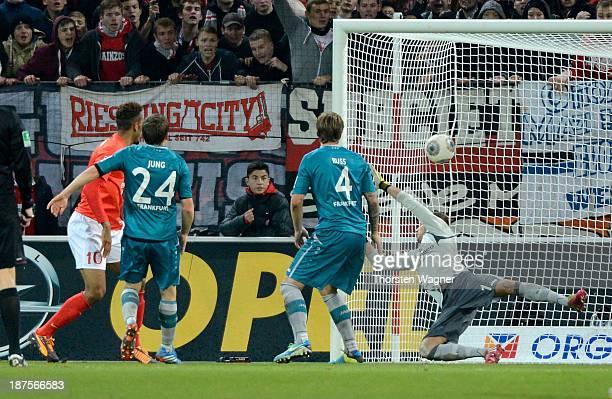 Eric Maxim ChoupoMoting of Mainz is scoring his teams opening goal during the Bundesliga match between FSV Mainz 05 and Eintracht Frankfurt at Coface...