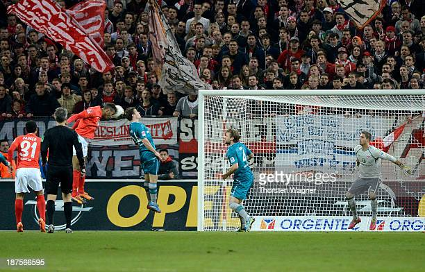 Eric Maxim Choupo-Moting of Mainz is scoring his teams opening goal during the Bundesliga match between FSV Mainz 05 and Eintracht Frankfurt at...