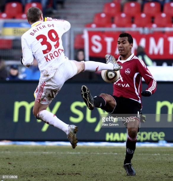 Eric Maxim ChoupoMoting of Nuernberg is challenged by Toni Kroos of Leverkusen during the Bundesliga match between 1 FC Nuernberg and Bayer...