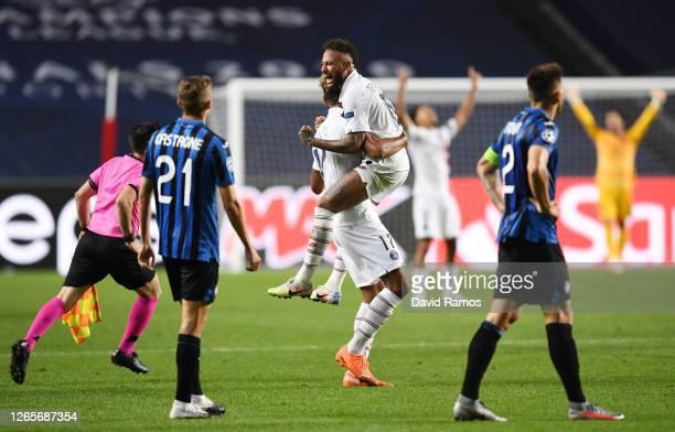 Eric Maxim Choupo-Moting of Paris Saint-Germain celebrates victory with Neymar during the UEFA Champions League Quarter Final match between Atalanta...