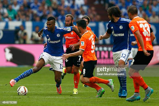Eric Maxim ChoupoMoting of Schalke battles for the ball with Jerome Gondorf of Darmstadt during the Bundesliga match between FC Schalke 04 and SV...