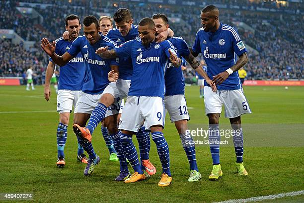 Eric Maxim ChoupoMoting of Schalke celebrates with team mates after scoring his team's second goal during the Bundesliga match between FC Schalke 04...