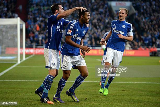 Eric Maxim ChoupoMoting of Schalke celebrates with team mates Christian Fuchs and Benedikt Hoewedes after scoring his team's second goal during the...