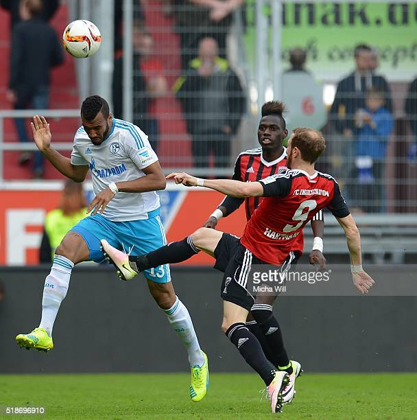 Eric Maxim ChoupoMoting of Schalke Danny da Costa of Ingolstadt and Moritz Hartmann of Ingolstadt tussle for the ball during the Bundesliga match...
