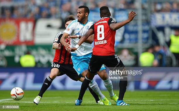 Eric Maxim ChoupoMoting of Schalke is challenged by Pascal Gross of Ingolstadt and Bernardo De Oliviera of Ingolstadt during the Bundesliga match...