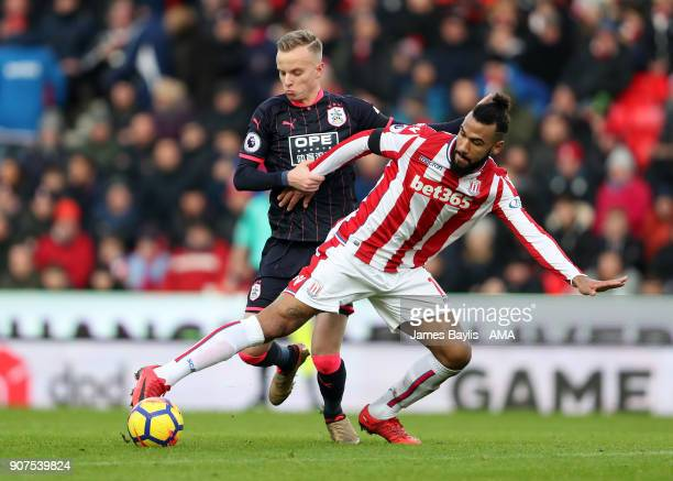 Eric Maxim ChoupoMoting of Stoke City and Florent Hadergjonaj of Huddersfield Town during the Premier League match between Stoke City and...