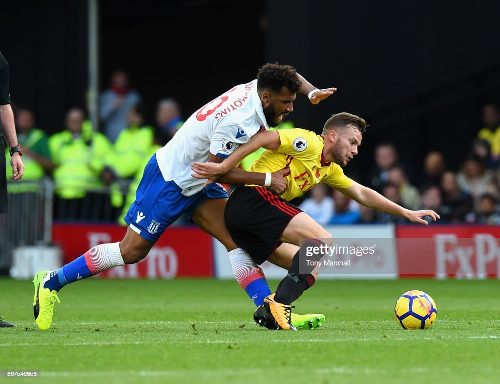 Eric Maxim Choupo-Moting of Stoke City tackles Tom Cleverley of Watford during the Premier League match between Watford and Stoke City at Vicarage Road on October 28, 2017 in Watford, England.