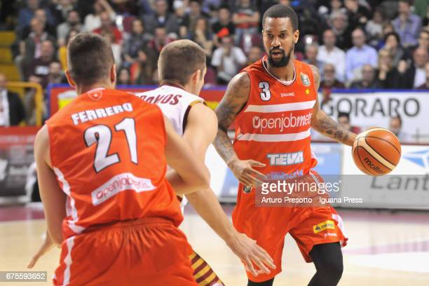Eric Maynor and Giancarlo Ferrero of Openjobmetis competes with Michael Bramos of Umana during the LegaBasket of Serie A1 match between Reyer Umana...