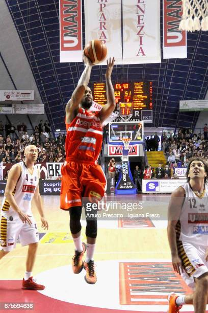 Eric Maynor of Openjobmetis competes with Ariel Filloy and Hrvoje Peric of Umana during the LegaBasket of Serie A1 match between Reyer Umana Venezia...