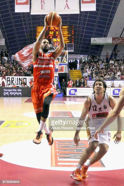 Eric Maynor of Openjobmetis competes with Ariel Filloy of Umana during the LegaBasket of Serie A1 match between Reyer Umana Venezia and Openjobmetis...