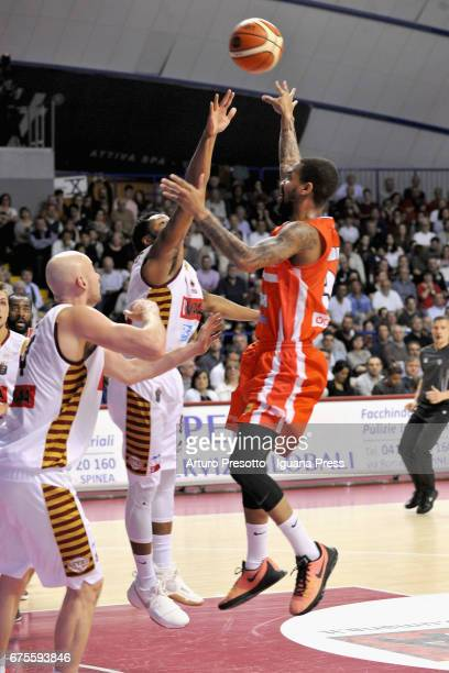 Eric Maynor of Openjobmetis competes with MarQuez Haynes and Hrvoje Peric of Umana during the LegaBasket of Serie A1 match between Reyer Umana...