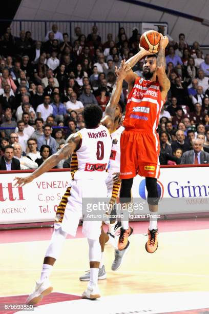Eric Maynor of Openjobmetis competes with MarQuez Haynes of Umana during the LegaBasket of Serie A1 match between Reyer Umana Venezia and...