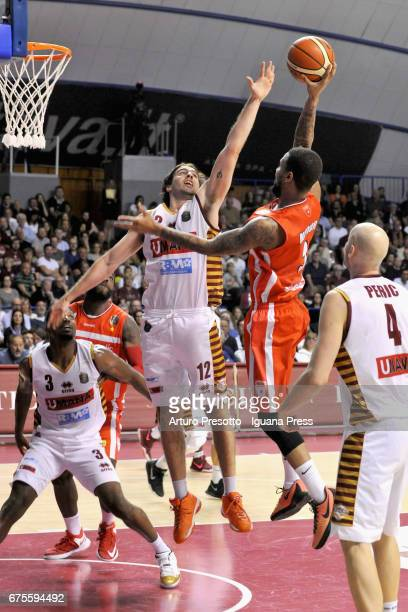 Eric Maynor of Openjobmetis competes with Melvin Ejim and Ariel Filloy and Hrvoje Peric of Umana during the LegaBasket of Serie A1 match between...