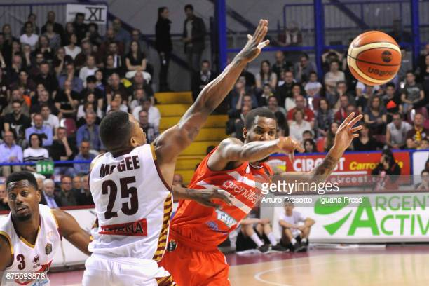 Eric Maynor of Openjobmetis competes with Melvin Ejim and Tyrus McGee of Umana during the LegaBasket of Serie A1 match between Reyer Umana Venezia...
