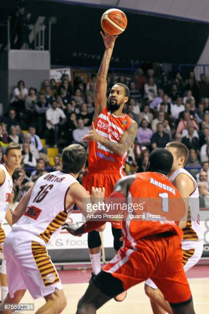 Eric Maynor of Openjobmetis competes with Stefano Tonut and Benjamin Ortner and Michael Bramos of Umana during the LegaBasket of Serie A1 match...