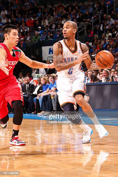 Eric Maynor of the Oklahoma City Thunder looks to pass the ball against Jeremy Lin of the Houston Rockets on November 28 2012 at the Chesapeake...
