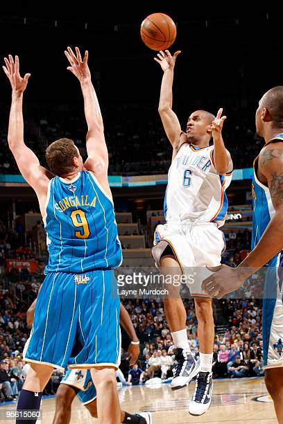 Eric Maynor of the Oklahoma City Thunder shoots the ball over Darius Songaila of the New Orleans Hornets on January 6 2010 at the Ford Center in...
