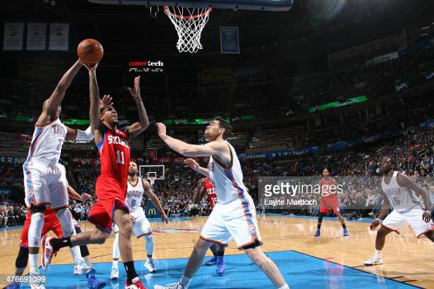 Eric Maynor of the Philadelphia 76ers goes up for the layup against the Oklahoma City Thunder during an NBA game on March 4 2014 at the Chesapeake...