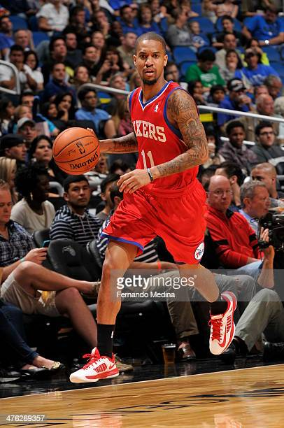 Eric Maynor of the Philadelphia 76ers handles the ball during a game against the Orlando Magic on March 2 2014 at Amway Center in Orlando Florida...