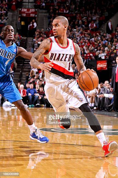 Eric Maynor of the Portland Trail Blazers drives against Darren Collison of the Dallas Mavericks on April 7 2013 at the Rose Garden Arena in Portland...
