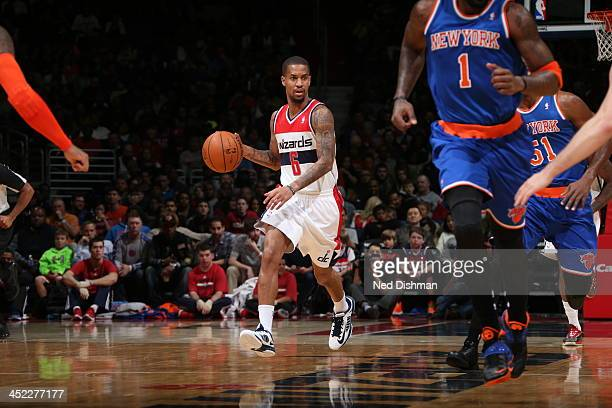 Eric Maynor of the Washington Wizards dribbles up the court against the New York Knicks during the game at the Verizon Center on November 23 2013 in...