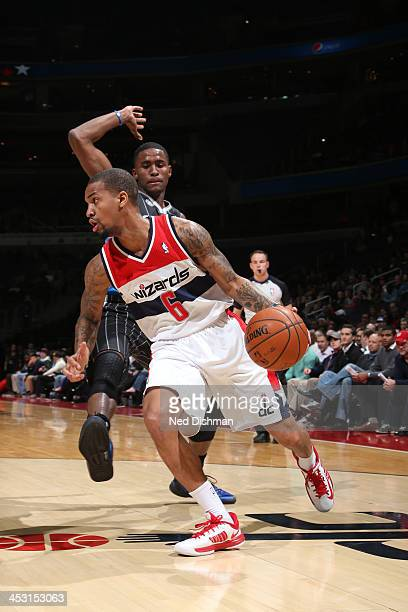 Eric Maynor of the Washington Wizards drives against the Orlando Magic during the game at the Verizon Center on December 2 2013 in Washington DC NOTE...