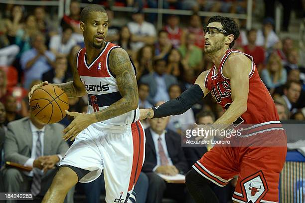 Eric Maynor of the Washington Wizards drives on Kirk Hinrich of the Chicago Bulls during Chicago Bulls v Washington Wizards NBA Global Games Rio 2013...